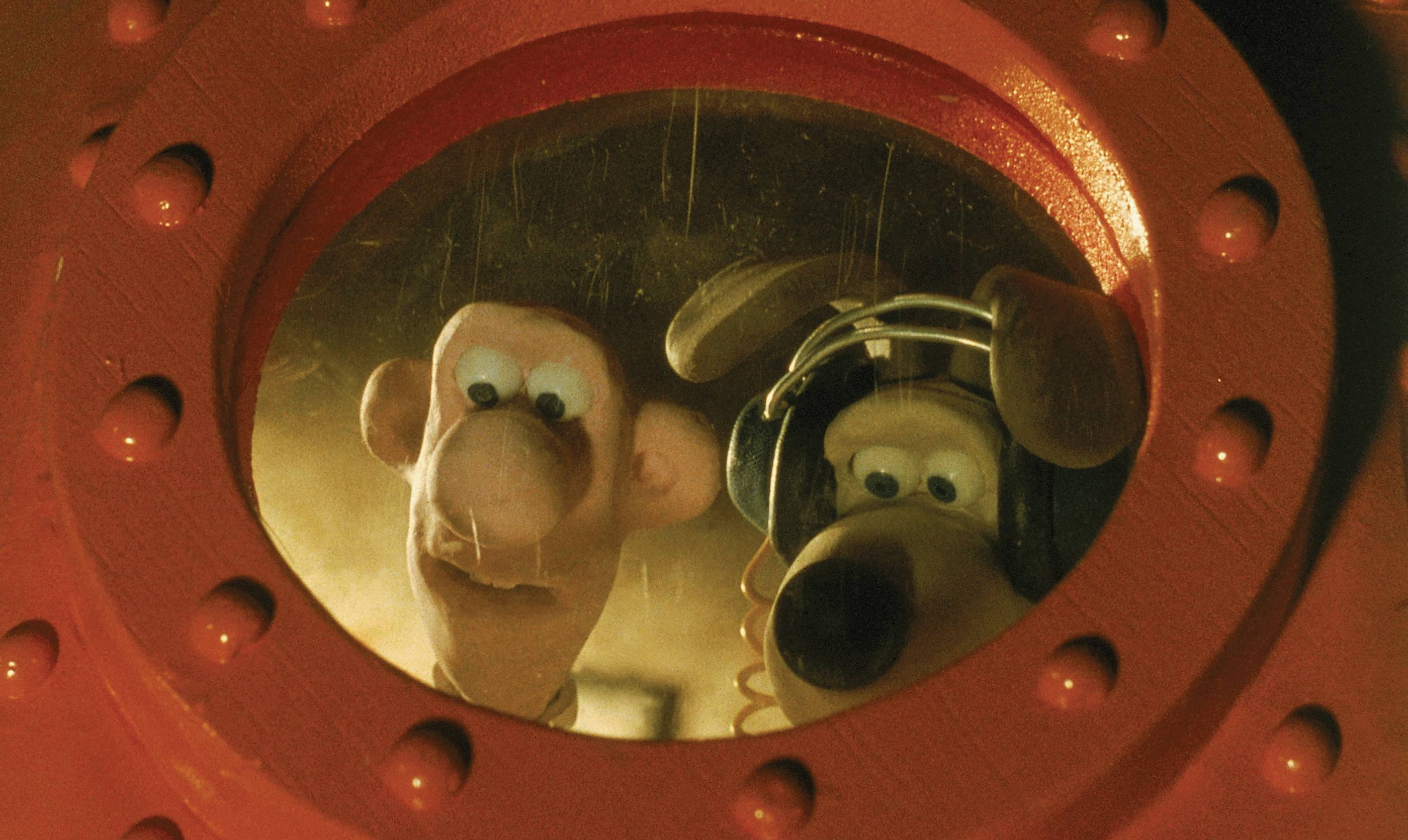 image of wallace and gromit (gromit wearing headphones) peering outside of a circular red spaceship window
